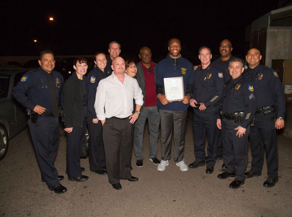 Phoenix Police Chief awards Roy Green and Larry Fitzgerald police chief  for life while David Gergen looks on